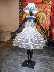 She's the Light of the Party (Steve Taylor (Photography)) Tags: red newzealand brown white black art mannequin hat fashion museum wow carpet grey design dress nelson nz southisland suitcase lampshade classiccars worldofwearableart