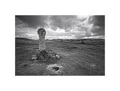 St Piran's Cross (silver/halide) Tags: blackandwhite bw monochrome clouds landscape mono ancient cornwall landmark historic granite celtic kernow perranporth johnbaker stpiran ancientstones stpiranscross penhalesands