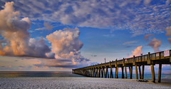 Early Morning At The Pier (Stuart Schaefer Photography) Tags: morning travel sky seascape beach gulfofmexico clouds sunrise landscape pier sand florida outdoor cloudscape pensacolabeach outdoorphotography pensacolabeachfishingpier