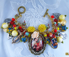 Our Lady of Mt. Carmel Cuzco School-Style Handmade Charm Bracelet (inspirational) Tags: religious catholic handmade jewelry bracelet handcrafted virginmary medals infantofprague virgenmaria patronsaints lampworkbeads ourladyoffatima virgendelcarmen nuestrasenora ourladyofmtcarmel santospatronos joyeriacatolica medallasreligiosas