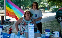 "pride-volunteers-pride-stall-2013<br /><span style=""font-size:0.8em;"">The Pride in Plymouth Stall staffed by volunteers at Pride in the Park 2013.</span> • <a style=""font-size:0.8em;"" href=""https://www.flickr.com/photos/66700933@N06/9371426601/"" target=""_blank"">View on Flickr</a>"
