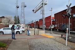 (huntingtherare) Tags: people train graffiti waiting crossing freight rollingstock rxr benching