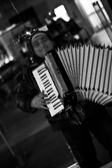 Didel di doo... (gerrit.photography) Tags: street city musician man guy strange smile night germany photography musiker poor hannover instrument grin hanover ziehharmonika