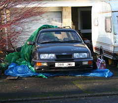 1987 FORD SIERRA GHIA 4X4 2.8 TURBO ESTATE (shagracer) Tags: cars abandoned rotting car dead paint estate flat 4x4 stickers neglected 4wd sierra turbo faded cover forgotten vehicle british rusting wreck dying dull tarpaulin awd decaying ghia stood unloved paintwork sorn laidup