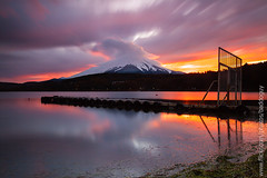 Cloud-capped Fujisan (baddoguy) Tags: longexposure sunset mountain lake reflection japan horizontal pier fuji cloudy tranquility images getty fujisan yamanashi tranquilscene yamanaka traveldestination cloudcapped