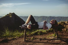 Hiker taking a rest on top of Mount Batur (Zhenya bakanovaAlex Grabchilev) Tags: life bali mountain male guy travelling indonesia relax landscape freedom volcano open outdoor top wildlife young free lifestyle mount rest hiker openspace batur
