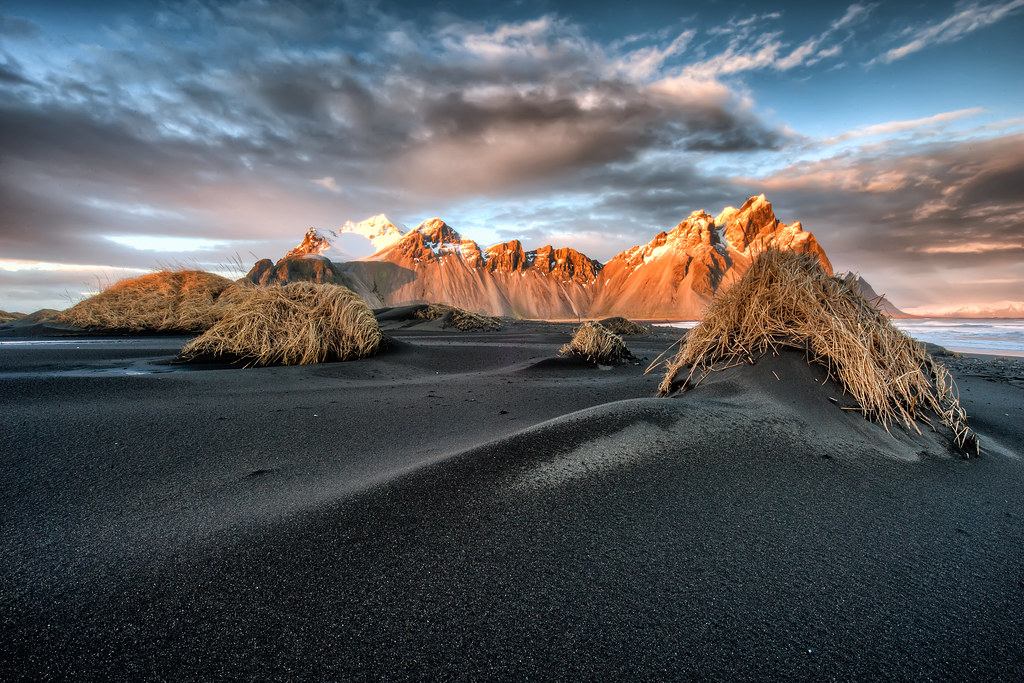 Mount Vesturhorn, Iceland.  This black sand beach with hills covered in straw makes for a great foreground to the massive mountain range.