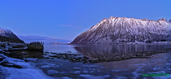 Panorama Morfjord 251212 Bllys (June Grnseth EFIAP PPSA) Tags: blue winter snow mountains ice norway clouds daylight wreck lofoten morfjord hadselsand arcticwinter bestphotolofoten