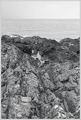 A Seascape (spodzone) Tags: sea portrait people blackandwhite art nature water pool lines composite composition manipulated vintage lens landscape photography scotland boat emotion unitedkingdom space horizon transport perspective hard dreary places equipment filter zen bland geology areas stark distance simple fishingboat toned contrasts dull portpatrick tranquil hdr indifference rockpool dumfriesandgalloway gbr leadinglines circularpolariser bigsmall rockstone nearfar digikam timelessness rockwater tonemapped landwater skyearth shapeandform rawconversion enfuse rawtherapee wacke simplecomplex digitalred sony1855 darktable digitalgradnd digitallowpass