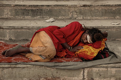 Sleeping Sadhu (Dick Verton ( more than 13.000.000 visitors )) Tags: travel sleeping red india asia streetlife streetscene varanasi streetview sadhu ghats laying streetshot dickverton
