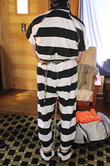 IMG_7920 (bob.laly) Tags: uniform chain jail shackles padlock handcuffs prisoner jumpsuit inmate
