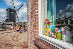 Bridge and mill @ Leiden (PaulHoo) Tags: street city bridge light urban holland color reflection mill window netherlands clouds fun leiden nikon citylife nik lightroom colorefex d700