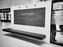 the barber's bench (Eire's Gorgeous Golden Gorse representative) Tags: bw monochrome bench tralee hbm iphone5 thebarber manorwestshoppingcentre 2016onephotoeachday