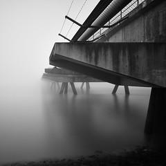 JadeWeserPort (McGeiwa) Tags: nebel steine brcke beton stacheldraht stahl flut