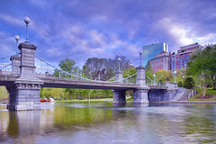 Boston Common (A. Shamandour) Tags: new city bridge sunset england storm motion color building art water boston clouds speed sunrise boats lights downtown cityscape photographer slow massachusetts commons places scape towards shutterspeed waterscape
