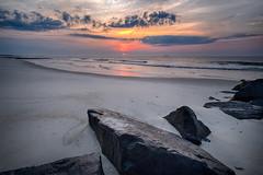 LBI - Sunrise (DJawZ) Tags: ocean morning sun color water clouds sunrise sand rocks waves hdr sunsetwx