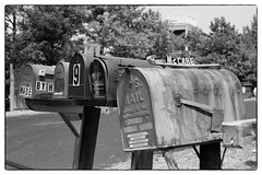 McCabe's Mailbox - Bethany Beach, DE (gastwa) Tags: ocean travel summer blackandwhite bw white black slr film beach work 50mm nikon focus scenery labor bethany andrew structure boardwalk plus delaware manual ilford fp4 manualfocus ais f12 fe2 gastwirth andrewgastwirth