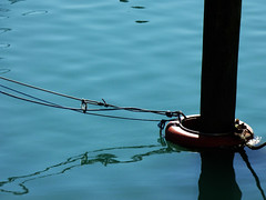 Mooring Glory (Steve Taylor (Photography)) Tags: blue red newzealand brown black reflection water marina ripple nelson rope canterbury quay ring pole nz mooring southisland bouy