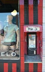 Ello...Ello? (timmerschester) Tags: street city red black reflection mannequin window shop wall phonebooth michigan stripes telephone communication disconnected royaloak outoforder