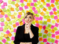 businesswoman-thinking-post-it-notes-ThinkstockPhotos (sarahmepstein) Tags: thinkstock thinking businesswoman woman professional notes pondering