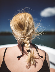 windblown (almostsummersky) Tags: ocean summer black water girl river hair bay boat us dress unitedstates maine windy sunny atlantic estuary windswept blonde boating tied atlanticocean windblown braid cascobay brackish westbath newmeadowsriver