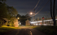 A Train Runs Through It ( estatik ) Tags: new old longexposure railroad night train three moving crossing nj bridges ave jersey flemington higginsville