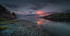 Silence (Tore Thiis Fjeld) Tags: sunset sea sky color beach nature norway clouds evening nikon rocks outdoor stones horizon le shore d800 hurum 14mm samyang skjttelvik