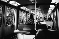 Riding the monorail. Seattle, WA. June 2016. (poopoorama) Tags: dannyngan dannynganphotography fujifilm seattle xseries x100t bw blackandwhite monorail people streetphotography washington unitedstates
