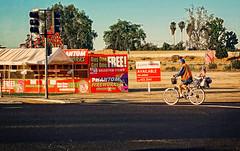 FOURTH (akahawkeyefan) Tags: signs man bike bicycle highway fireworks flags 99 patriot kingsburg davemeyer