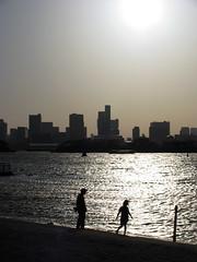 2 (  / Yorozuna) Tags: sunset sea people sunlight reflection building beach silhouette backlight tokyo bay coast seaside shine  odaiba daiba seashore     tokyobay                     minatoward   odaibaseasidepark