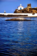 (dimitra_milaiou) Tags: life door blue light sea sky sun lighthouse white castle love church beautiful rock architecture landscape island greek nikon europe place bell stones d small aegean hellas visit greece hora orthodox 90 chora andros dimitra d90    aigaio     milaiou