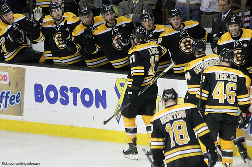Bruins bench celebrates a goal