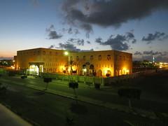 Faculty Of Medicine, New Damietta (WhyCallSarah) Tags: city nightphotography urban building yellow clouds canon geotagged dusk egypt illumination medical health ochre dumyat damietta sx40 دمياط newdamietta