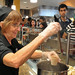 A Flashpoint cook ladles out beef noodles at On The Oval, University Dining's on Centennial Campus.UD.Oval.4273