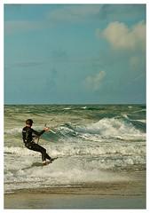 Wind surfing (Bernzfotos - Bernard Golder Photography) Tags: ocean newzealand sky sun reflection beach nature water beautiful beauty clouds fun amazing sand nikon pretty surf waves wind wave surfing riding shore nz northisland windsurfing nikkor seashore mtmaunganui tauranga photooftheday bayofplenty d300 nouvellezlande papamoa waterfoam nikond300 nikkorvr18105mmf35 bernzfotos