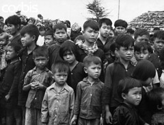 ca. 1970, Cambodia (tommy japan) Tags: people portraits children asia cambodia southeastasia vietnamese asians many refugee crowd group males females dwelling refugeecamp politicalandsocialissues halflengthportraits southeastasians vietnamwar19591975 temporaryhousing