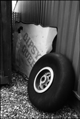 Out back (ihavenowords) Tags: white black art history film home wheel june wall museum plane canon out airplane eos mono back panel display kodak tmax scanner 5 parts aircraft aviation military shed scan queen developer 400 epson 16 16th gypsy processed developed eos5 ef 1740 gravel noseart f4l 2013 4490