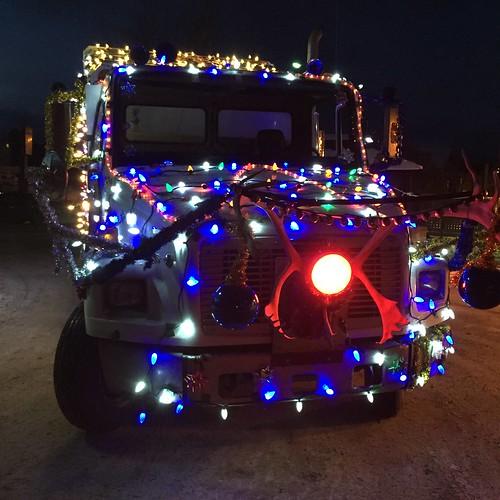 Santa emerges from his garbage truck. Whitehorse, Yukon.