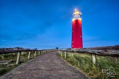 Texel Lighthouse (Fotografie Etienne Hessels) Tags: blue light lighthouse holland netherlands dutch strand landscape licht landscapes wadden waddeneiland flickr blauw outdoor sony pad nederland wolken sigma lucht 1020mm etienne duinen vuurtoren hdr texel hout buiten landschap stenen hessels eilanden hollanda sonyilca77m2