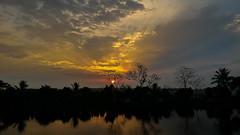 Another sunrise for the believers (Mijan Rashid) Tags: morning blue shadow sky cloud sun tree water clouds sunrise golden dhaka asus bangladesh brac goldenhour waterscape beautifulbangladesh