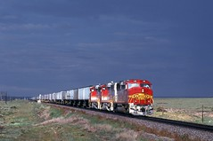 90-9-7 ATSF148 12-02 (jhwright105) Tags: railroad newmexico lucy westbound stormclouds atsf tofc gp60m superfleet
