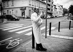 Taking a break (graveur8x) Tags: man butcher break cigarette smoking takingabreak candid offenbach germany main blackandwhite street streetphotography deutschland lumixcm1 panasonicdmccm1