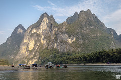 Nine Horse Mural Hill, Guilin (lycheng99) Tags: china travel sky horses mountains nature landscape boats liriver mural guilin bluesky tourists karst guangxi rive xingping chinatravel líjiāng karstformation ninehorse ninehorsemuralhill