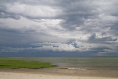 Storms Over the Bay (brucetopher) Tags: ocean sky cloud storm green beach water rain weather clouds grey bay coast waves gloomy wind gray dramatic front atlantic coldfront heavy storms seagrass seacoast heavyweather weatherfront amazingsky foulweather amazingskies weathermaker