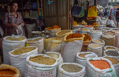 Spices and Pasta in an Ethiopian market (Peraion) Tags: africa woman colours market pasta spices ethiopia sacks