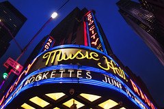 Radio City Music Hall (Brandon Godfrey) Tags: newyorkcity newyork radiocitymusichall manhattan midtown nyc rockafellarcenter bluehour city urban fisheye 30rock architecture sign bright text usa america