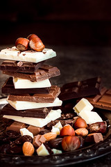 Chocolate / Chocolate bar / chocolate background/chocolate tower and nuts. (azimavu) Tags: chocolate sweet sweets dessert background food candy delicious brown cocoa dark gourmet white tasty eat assortment snack chocolates gift sugar macro black bonbon bar milk cinnamon bitter ingredient calorie confectionery wooden cacao fat nut many group tower stack piece texture hazelnut closeup broken slice