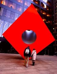 Red Cube (sinbadcc1) Tags: street nyc sculpture newyork couple streetphoto wallstreet redcube