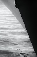 The Blade (pietrowsky) Tags: blackandwhite white abstract black film monochrome 35mm boat ship kodak fineart minimal scan negative bow analogue minimalism conceptual canonae1 trix400 filmisnotdead believeinfilm