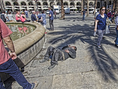 African tourism (Jan Kranendonk) Tags: barcelona street plaza sleeping people man fountain drunk spain europe african down tourist spanish passedout unconscious migrant